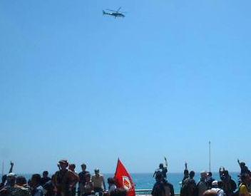 Police helicopter and crowd at G8 protests in Genoa
